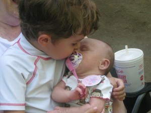 Dane kissing baby cousin
